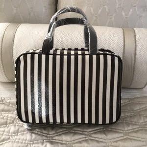 Henri Bendel striped weekender